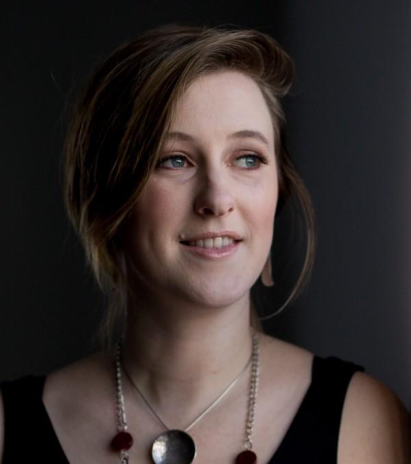 A portrait of Victoria Smith in a black tank top.